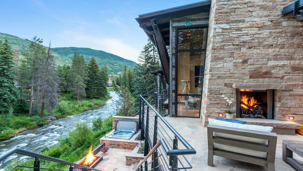 Modern home with outdoor, back yard, trees, shrubs, grass, flowers, boulders, walkways, post lighting, large patio, porch, deck, landscape lighting, stone patio, porch, deck, and hanging lighting. Scene Stealer  Photo 16 of Beaver Dam Luxury