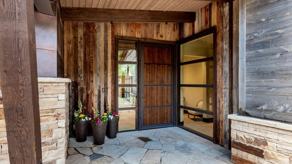 Modern home with doors, exterior, metal, wood, and swing door type. Front Entry Photo 14 of Beaver Dam Luxury