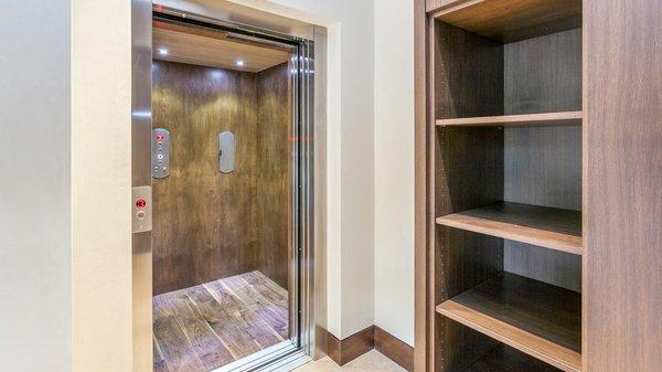 Modern home with storage room, cabinet storage type, shelves storage type, and closet storage type. Mudroom with Elevator  Photo 8 of Beaver Dam Luxury