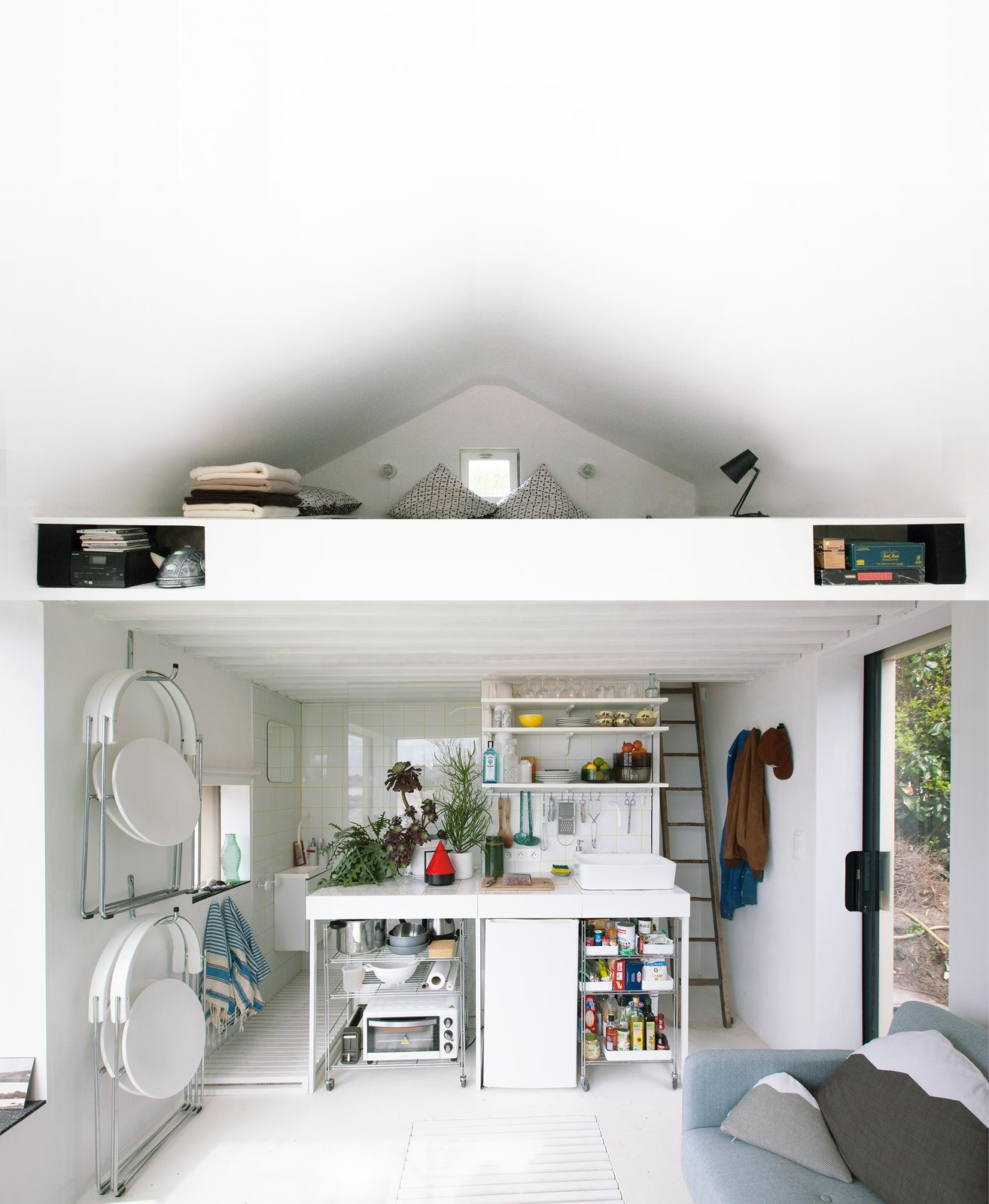 @aubry.guillaume Tagged: Kitchen, Tile Counter, White Cabinet, Ceramic Tile Backsplashe, Refrigerator, Ceiling Lighting, and Vessel Sink.  Viking Seaside Summer Cabin by zi ouiggy
