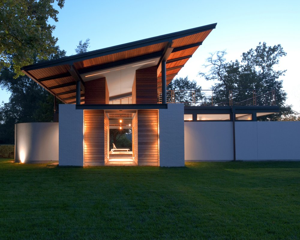 The view at night. Tagged: Outdoor, Side Yard, Front Yard, Back Yard, Field, Rooftop, Small Patio, Porch, Deck, Large Patio, Porch, Deck, Wood Patio, Porch, Deck, Landscape Lighting, Decking Patio, Porch, Deck, and Hanging Lighting.  A Summer House by McInturff Architects