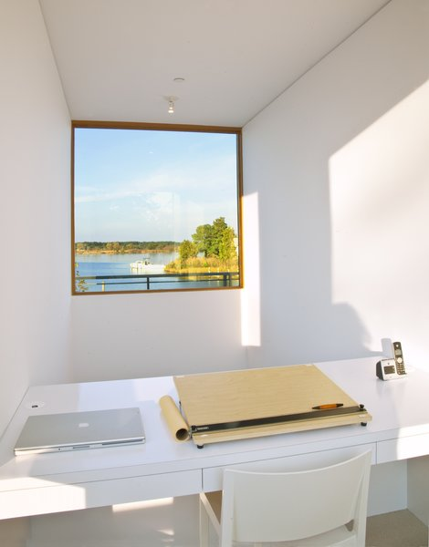 Modern home with office, study, desk, and storage. The owners desk peers out over the kitchen toward the water. Photo  of Chesapeake Bay House