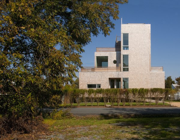 The exterior of the home is clad in white cedar shingles. Photo 7 of Chesapeake Bay House modern home