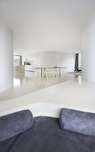 Modern home with dining room, chair, and table. Photo 7 of Family House Prototype