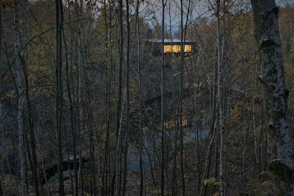 Modern home with outdoor, woodland, trees, and slope. Photo  of Family House Prototype
