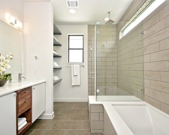 Modern home with bath room, granite counter, engineered quartz counter, marble counter, quartzite counter, drop in sink, ceramic tile floor, alcove tub, drop in tub, open shower, recessed lighting, full shower, and ceramic tile wall. Photo 9 of 809 W. Live Oak