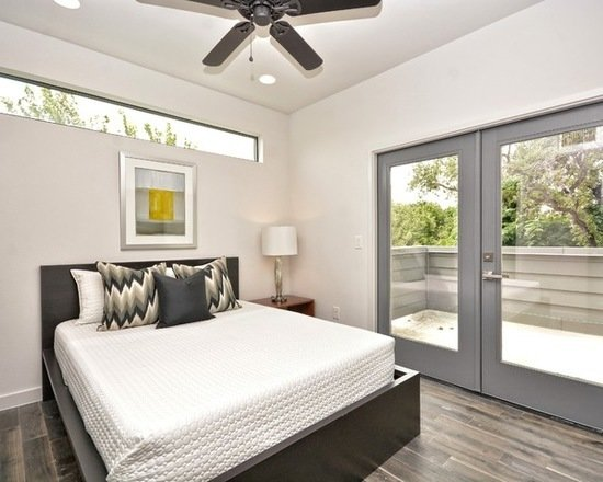 Modern home with bedroom, bed, chair, wardrobe, dresser, storage, bookcase, bunks, night stands, bench, shelves, floor lighting, recessed lighting, track lighting, light hardwood floor, and ceiling lighting. Photo 10 of 809 W. Live Oak