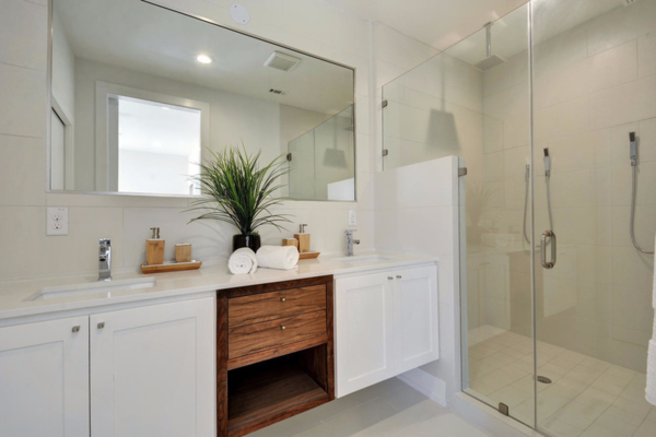Modern home with bath room, engineered quartz counter, ceramic tile floor, drop in sink, porcelain tile floor, enclosed shower, full shower, ceiling lighting, and ceramic tile wall. Bathroom Photo 2 of Johanna