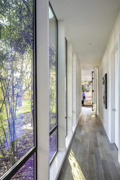 Modern home with windows, picture window type, and metal. Hallway Photo 2 of Strass I