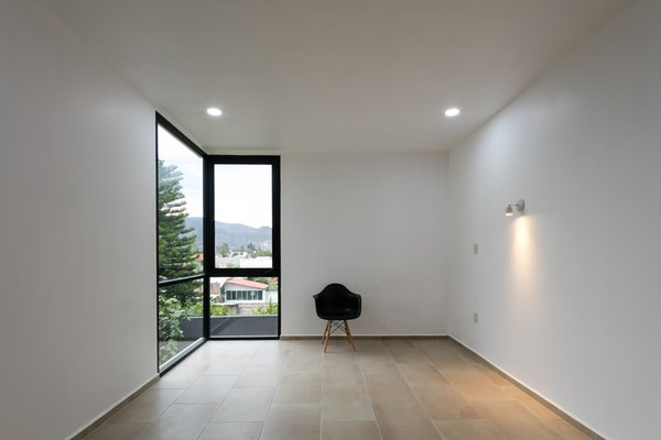 Modern home with bedroom, ceramic tile floor, and wall lighting. Photo 7 of Nacional 135 House