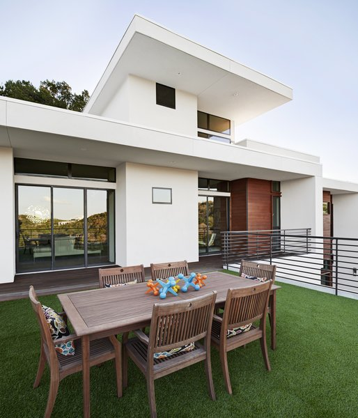 Modern home with outdoor, front yard, rooftop, garden, large patio, porch, deck, horizontal fence, grass, and hardscapes. exterior/roof deck Photo 2 of Westlake4