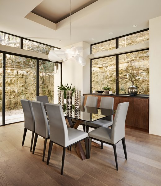 Modern home with dining room, chair, table, pendant lighting, storage, accent lighting, recessed lighting, and light hardwood floor. dining Photo 4 of Westlake4