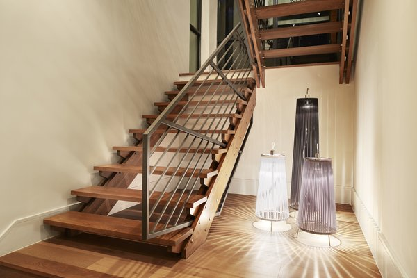 Modern home with staircase, wood tread, and metal railing. staircase Photo 5 of Westlake4