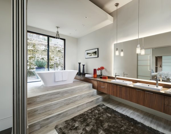 Modern home with bath room, engineered quartz counter, ceramic tile floor, carpet floor, freestanding tub, vessel sink, pendant lighting, soaking tub, recessed lighting, accent lighting, and wall lighting. master bath 1 Photo 10 of Westlake4