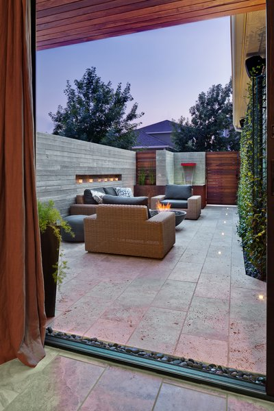 Modern home with outdoor, back yard, garden, shrubs, hardscapes, gardens, walkways, concrete pool, small pool, large patio, porch, deck, stone patio, porch, deck, concrete patio, porch, deck, landscape lighting, and horizontal fence. living room access Photo 2 of Mueller 1