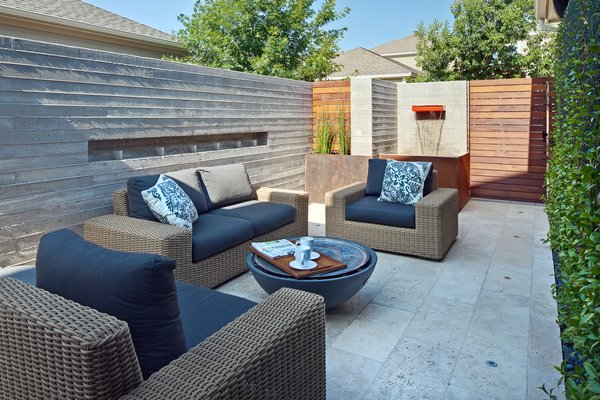 Modern home with outdoor, shrubs, back yard, garden, hardscapes, small pool, stone patio, porch, deck, horizontal fence, large patio, porch, deck, metal patio, porch, deck, metal fence, and landscape lighting. outdoor living room-morning Photo 4 of Mueller 1