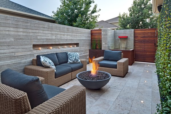 Modern home with outdoor, shrubs, garden, back yard, gardens, walkways, small pool, hardscapes, concrete pool, large patio, porch, deck, stone patio, porch, deck, metal patio, porch, deck, horizontal fence, planters patio, porch, deck, metal fence, and landscape lighting. outdoor living room-evening Photo 5 of Mueller 1