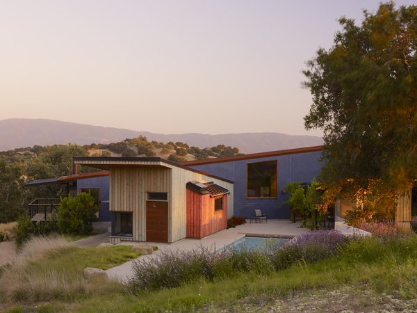 Modern home with outdoor, trees, grass, back yard, small pool, shrubs, swimming pool, and small patio, porch, deck. Photo  of Santa Ynez House