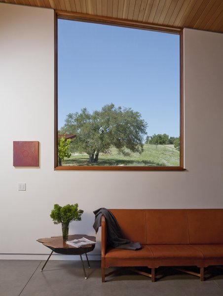 Modern home with living room, sofa, and concrete floor. Photo 6 of Santa Ynez House