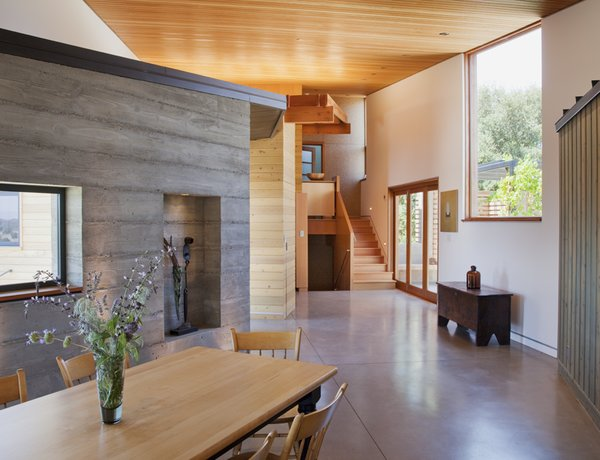 Modern home with dining room, concrete floor, chair, and table. Photo 7 of Santa Ynez House