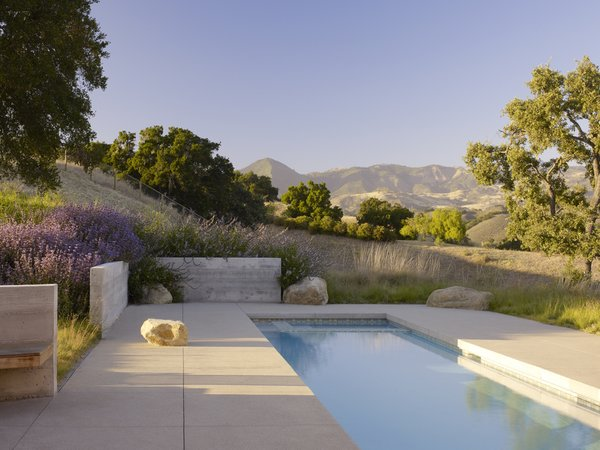 Modern home with outdoor, small pool, back yard, trees, concrete patio, porch, deck, swimming pool, small patio, porch, deck, and flowers. Photo 14 of Santa Ynez House