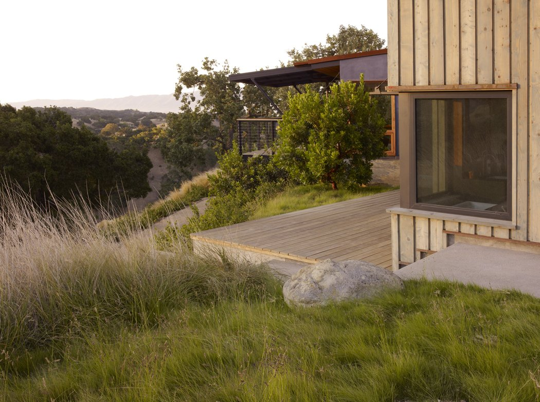 Tagged: Outdoor, Trees, Back Yard, Shrubs, Grass, Small Patio, Porch, Deck, and Wood Patio, Porch, Deck.  Santa Ynez House by Fernau & Hartman Architects