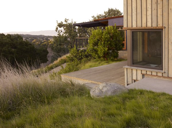 Modern home with outdoor, trees, back yard, shrubs, grass, small patio, porch, deck, and wood patio, porch, deck. Photo 15 of Santa Ynez House