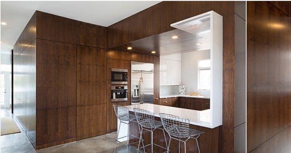Modern home with doors, wood, interior, and sliding door type. Photo  of MEK RESIDENCE