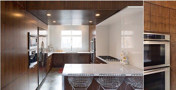 Modern home with kitchen, stone counter, wood cabinet, laminate cabinet, white cabinet, glass tile backsplashe, concrete floor, and stone slab backsplashe. Photo 2 of MEK RESIDENCE
