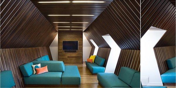 Modern home with bench, ceiling lighting, sofa, dark hardwood floor, shed & studio, home theater, den, and family room. Photo 4 of MEK RESIDENCE