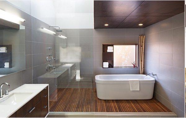 Modern home with bath room, stone counter, dark hardwood floor, and porcelain tile floor. Photo 7 of MEK RESIDENCE