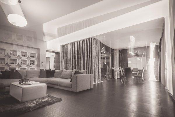 Modern home with living room, sofa, coffee tables, bookcase, ceiling lighting, and dark hardwood floor. Photo 6 of Voluntari Residence