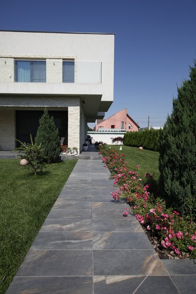 Modern home with outdoor, front yard, and grass. Photo 3 of Voluntari Residence