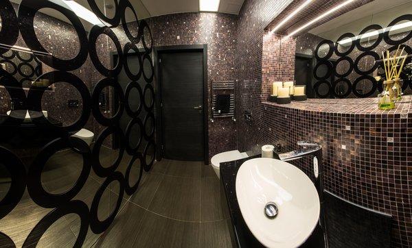 Modern home with bath room, track lighting, vessel sink, dark hardwood floor, freestanding tub, and ceramic tile wall. Photo 13 of Voluntari Residence