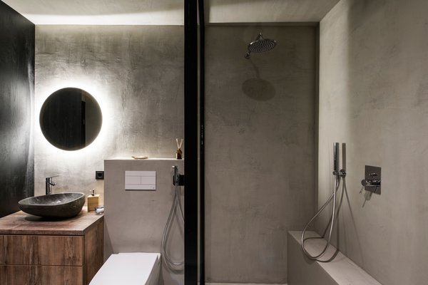 Modern home with bath room, ceiling lighting, laminate counter, open shower, concrete floor, accent lighting, concrete wall, vessel sink, and one piece toilet. Photo 9 of Drills&Hollywood