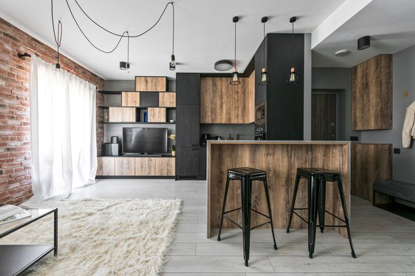 Modern home with living room, bar, lamps, shelves, media cabinet, chair, bookcase, stools, ceiling lighting, table, storage, pendant lighting, and laminate floor. Photo 3 of Drills&Hollywood