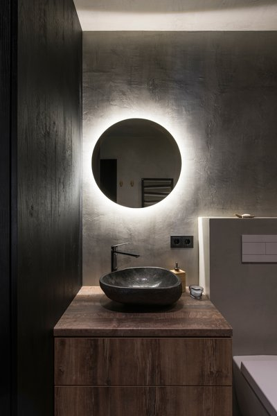 Modern home with bath room, laminate counter, concrete floor, open shower, vessel sink, ceiling lighting, wall lighting, accent lighting, concrete wall, and one piece toilet. Photo 11 of Drills&Hollywood