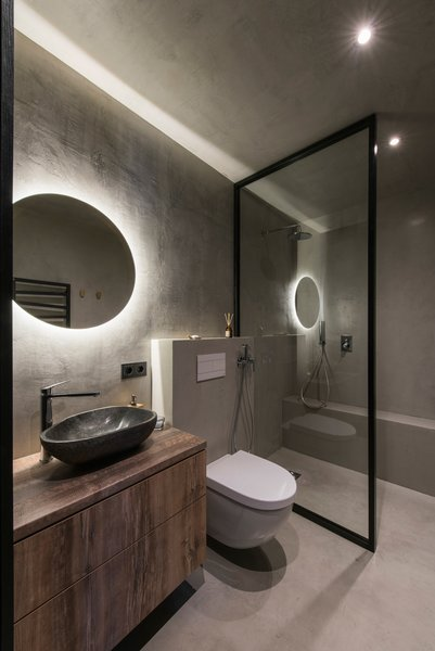 Modern home with bath room, laminate counter, open shower, concrete floor, ceiling lighting, accent lighting, concrete wall, one piece toilet, vessel sink, and wall lighting. Photo 12 of Drills&Hollywood