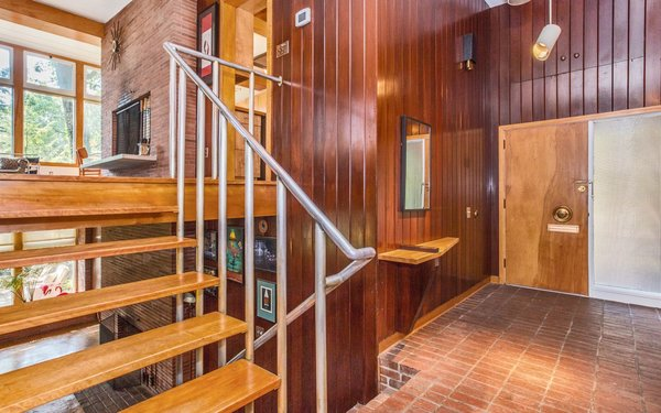 Modern home with hallway and brick floor. Entry Foyer Photo 4 of Classic Mid Century Modern home for sale