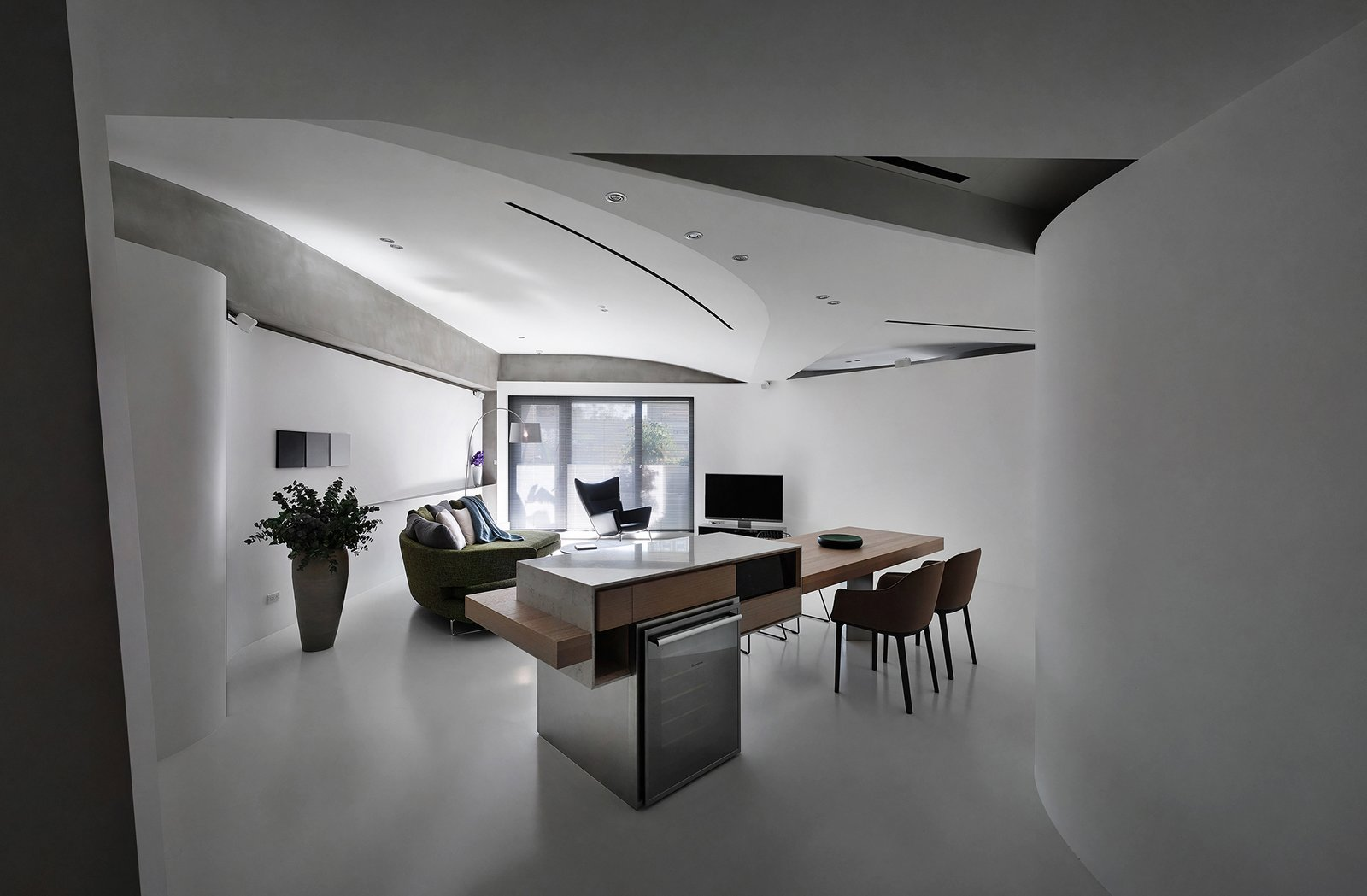 When entering the house, one could easily perceive its fluidity at the first glance. Tagged: Living Room, Bar, Table, Chair, Sofa, Wall Lighting, Ceiling Lighting, Lamps, and Concrete Floor.  Fluid House by shi-chieh lu