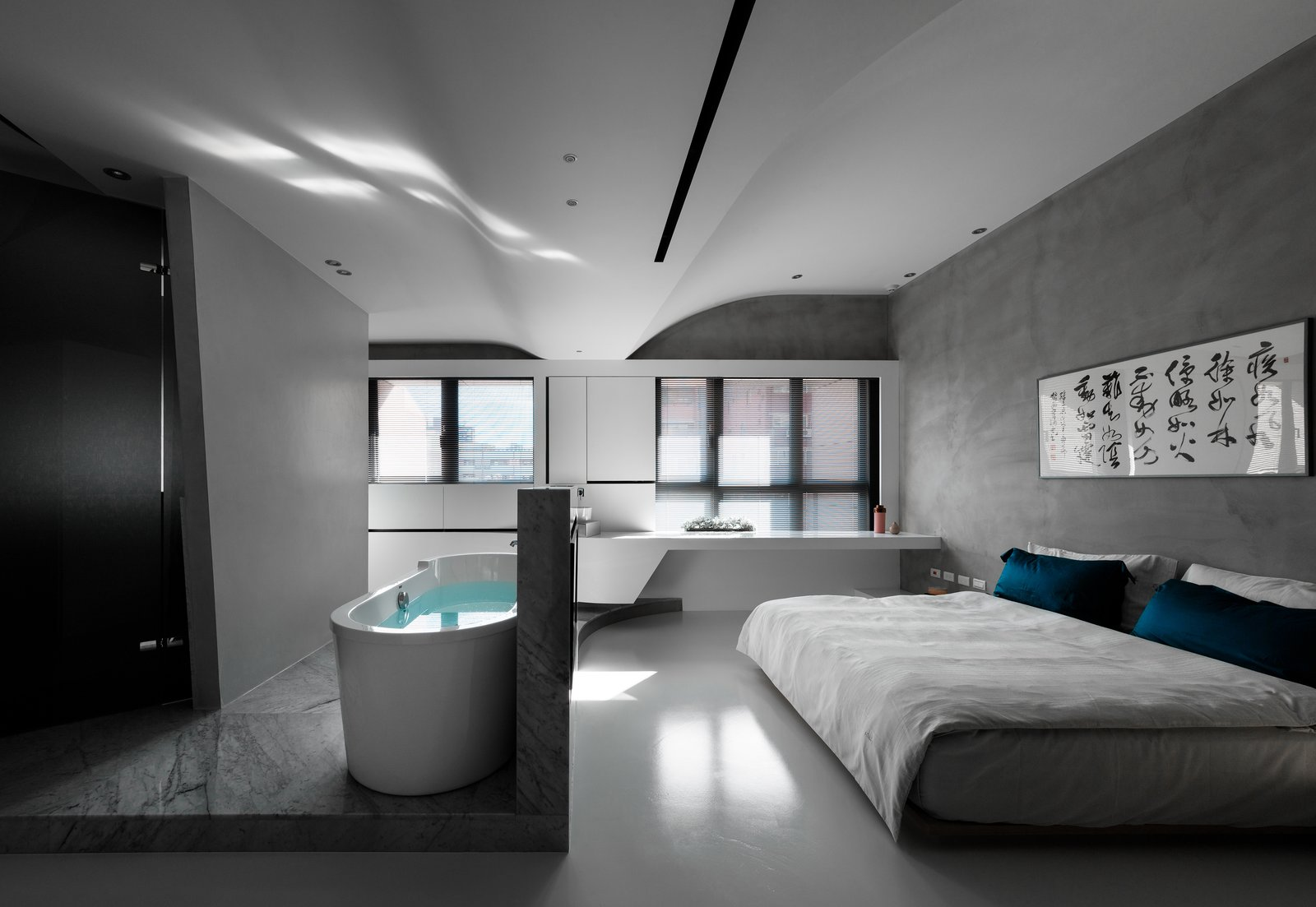 The bathtub splits from the bathroom and is separately located in the middle, diverting the circulation around it. Tagged: Bedroom, Ceiling Lighting, Marble Floor, Bed, and Concrete Floor.  Fluid House by shi-chieh lu