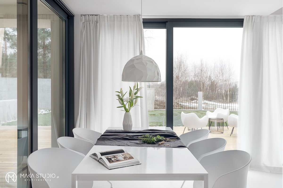 Tagged: Dining Room, Chair, Table, Pendant Lighting, and Lamps.  Minimal Seaside Villa by MAKA Studio