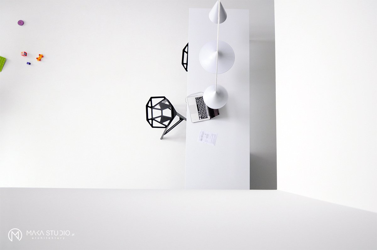 Tagged: Kitchen, Stone Counter, Stone Slab Backsplashe, White Cabinet, and Pendant Lighting.  Minimal Seaside Villa by MAKA Studio