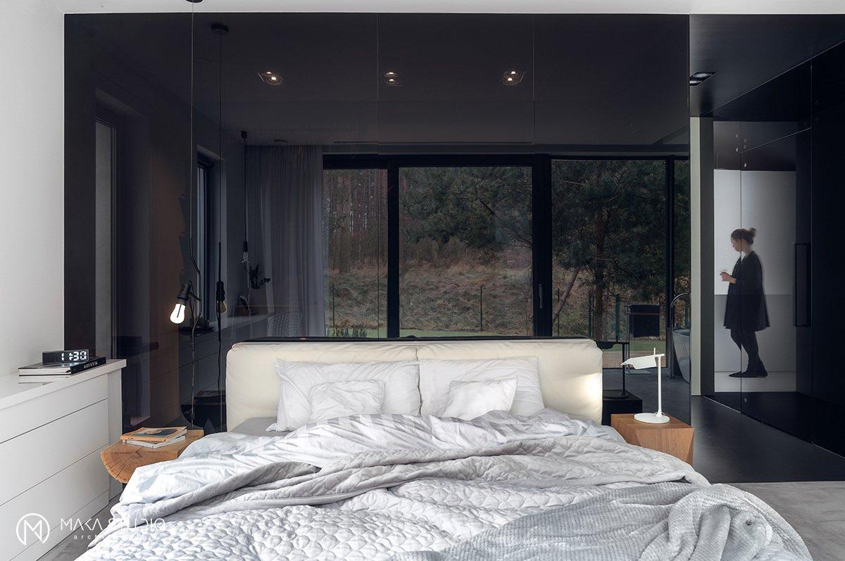 Tagged: Bedroom, Table Lighting, Wardrobe, Bed, Wall Lighting, and Concrete Floor.  Minimal Seaside Villa by MAKA Studio