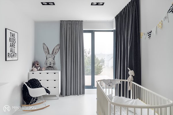 Modern home with kids room, playroom, bedroom, bed, dresser, rockers, lamps, chair, toddler age, neutral gender, and boy gender. Photo 9 of Minimal Seaside Villa