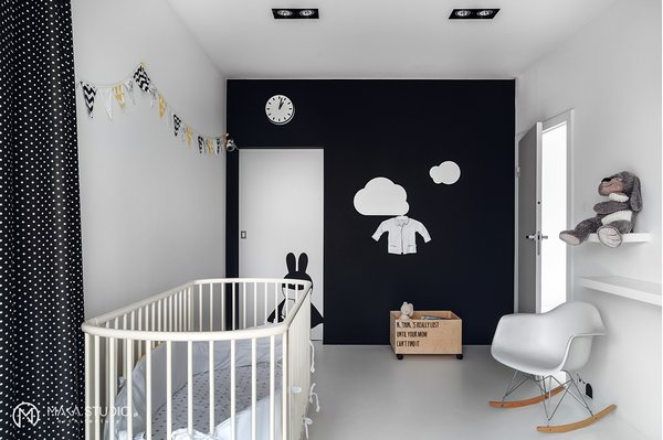 Modern home with kids room, bedroom, bed, playroom, chair, bookcase, rockers, boy gender, toddler age, and neutral gender. Photo 7 of Minimal Seaside Villa