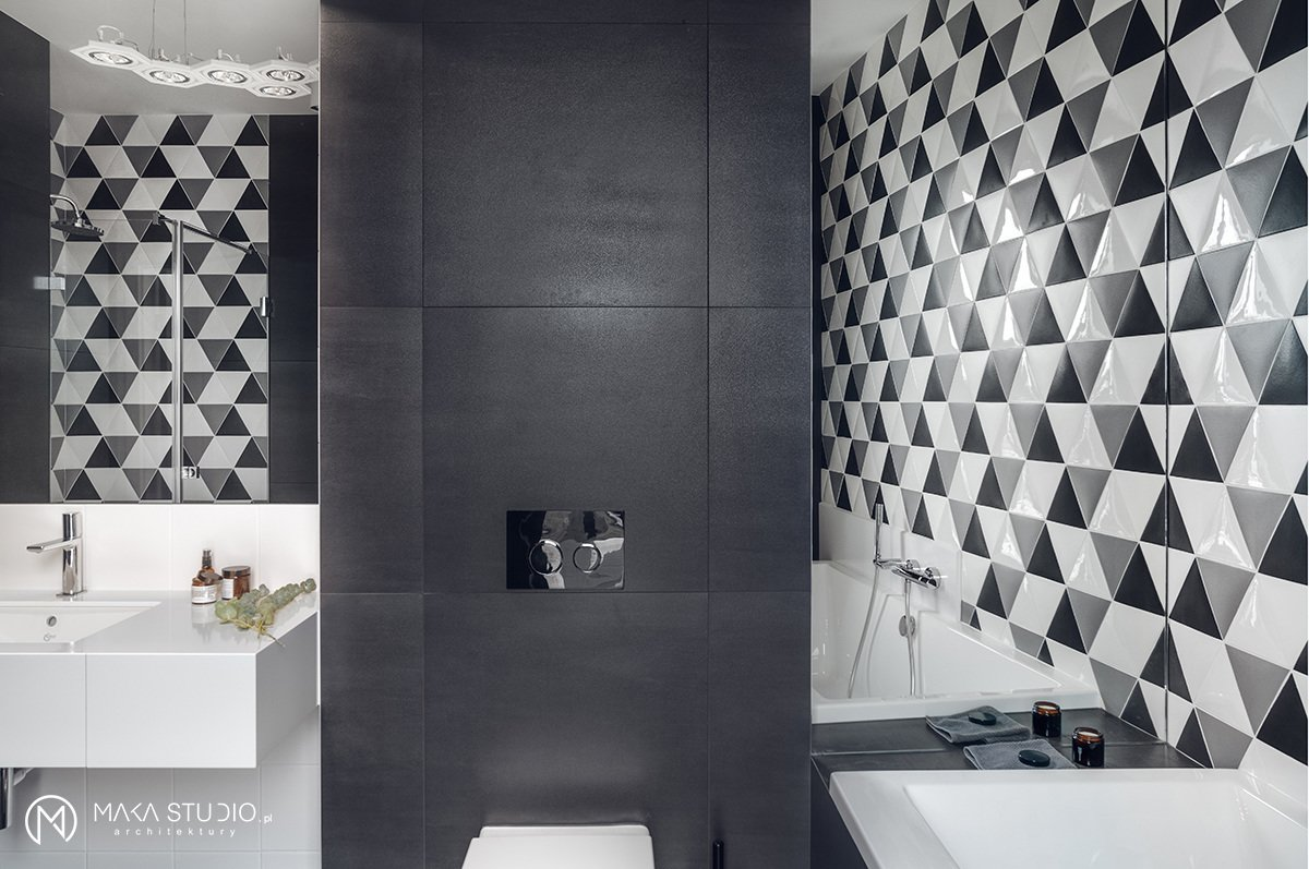 Tagged: Bath Room, Engineered Quartz Counter, Undermount Sink, Ceramic Tile Floor, Drop In Tub, Porcelain Tile Floor, Corner Shower, Ceiling Lighting, Pendant Lighting, Ceramic Tile Wall, and One Piece Toilet. Minimal Seaside Villa by MAKA Studio