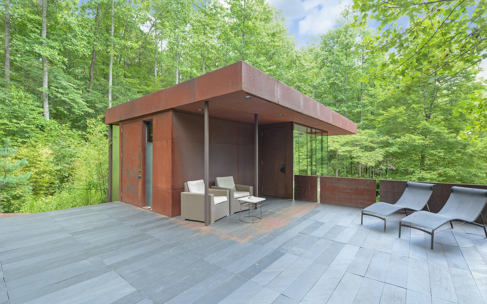 'Tree House' - Terrace Tagged: Rooftop, Metal Patio, Porch, Deck, Stone Patio, Porch, Deck, Metal Fences, Wall, Exterior, Metal Roof Material, and Metal Siding Material.  Mountain House Modern by Sarah Gillespie - The Lake Team