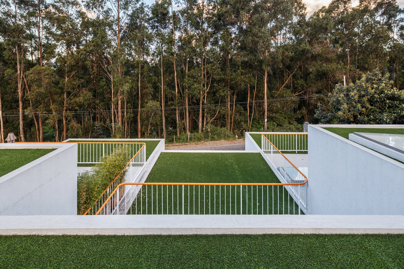 Tagged: Outdoor, Front Yard, Rooftop, Gardens, Trees, Metal Fence, and Woodland. FF Houses by TEC Taller EC