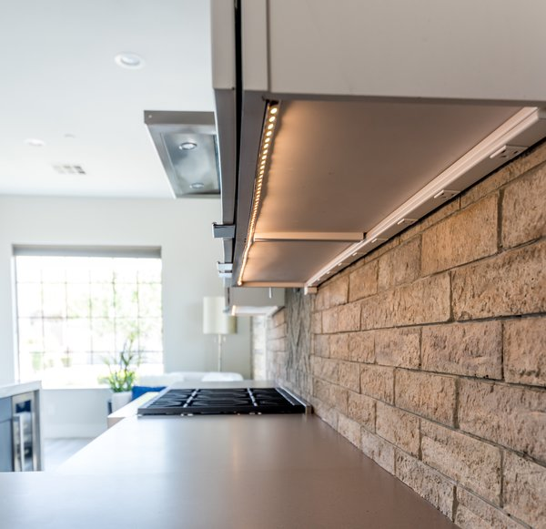 LED Lighting and GFI electrical strips are hidden underneath cabinets for a clean look.